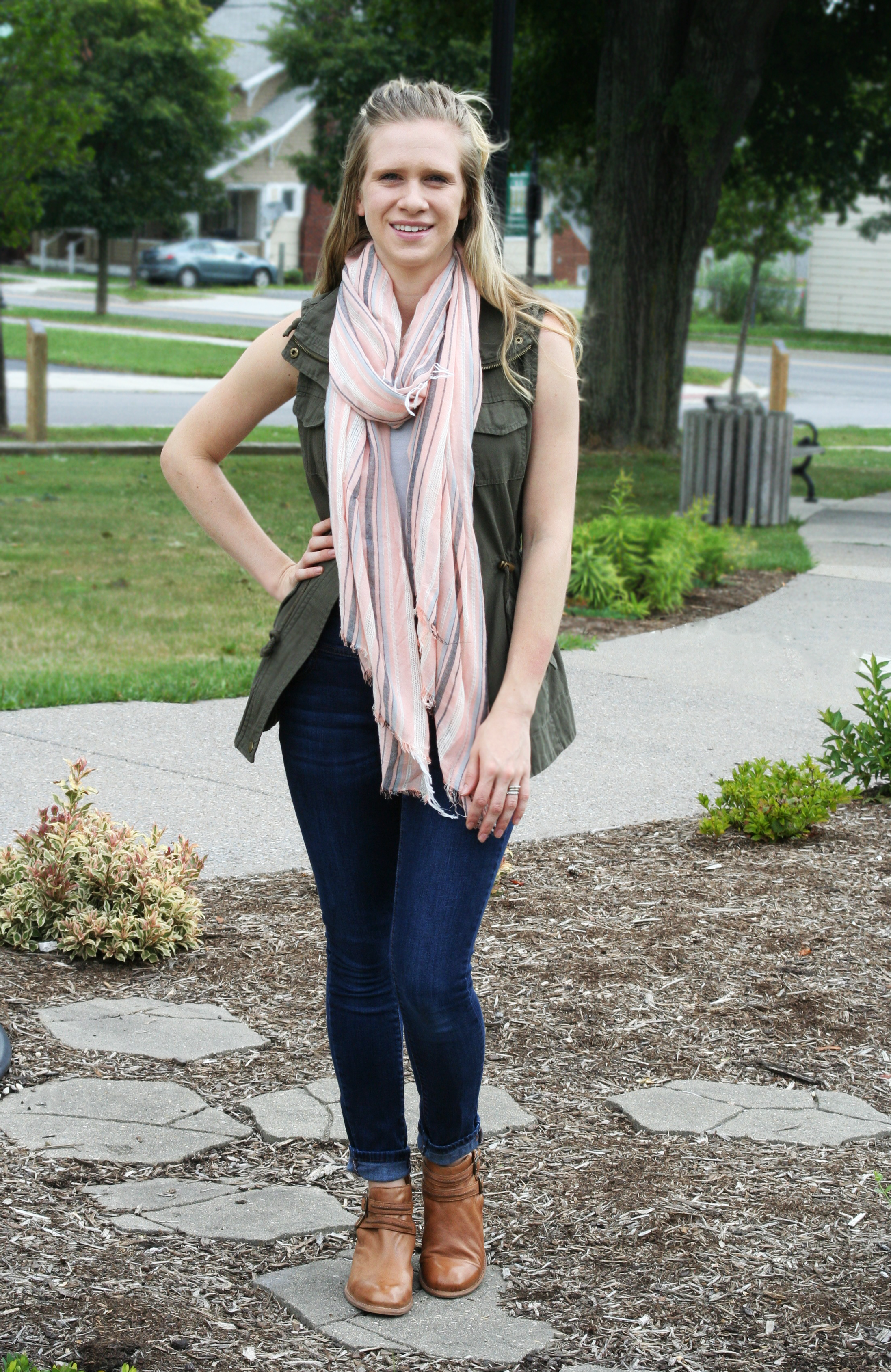 utility vest and striped scarf