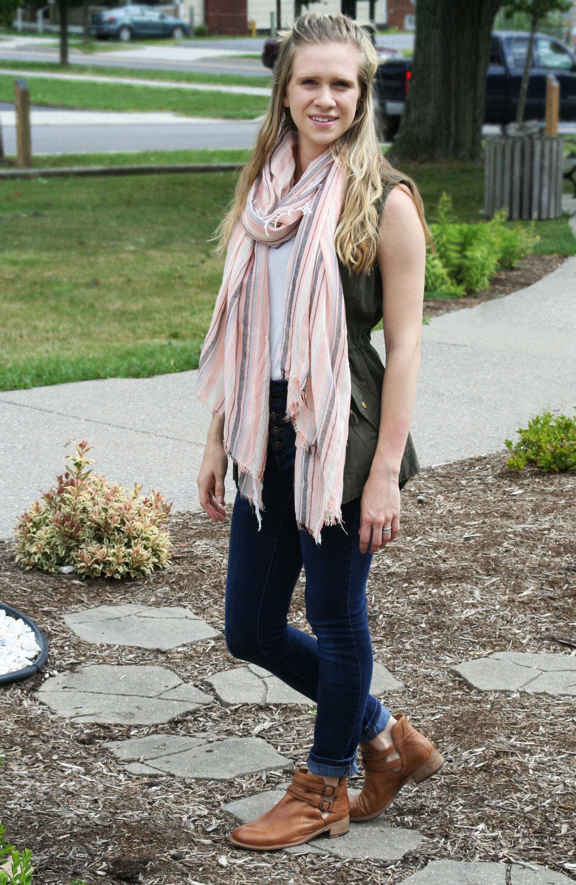 striped scarf and utility vest