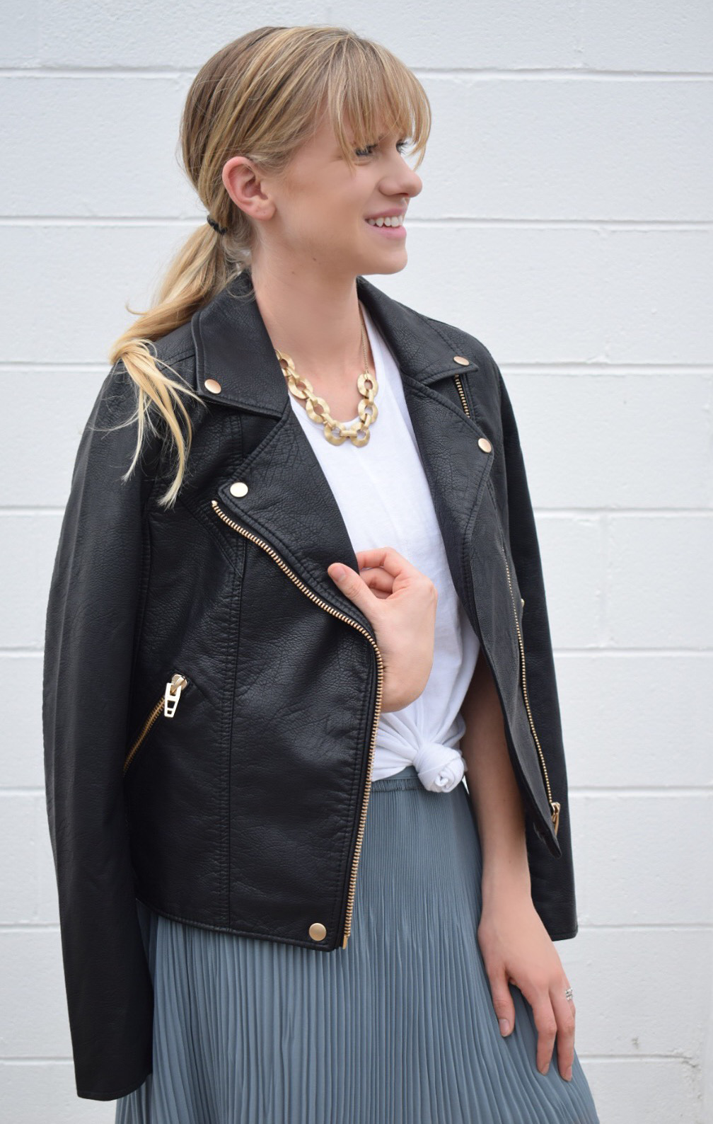 moto leather jacket with skirt and white tank