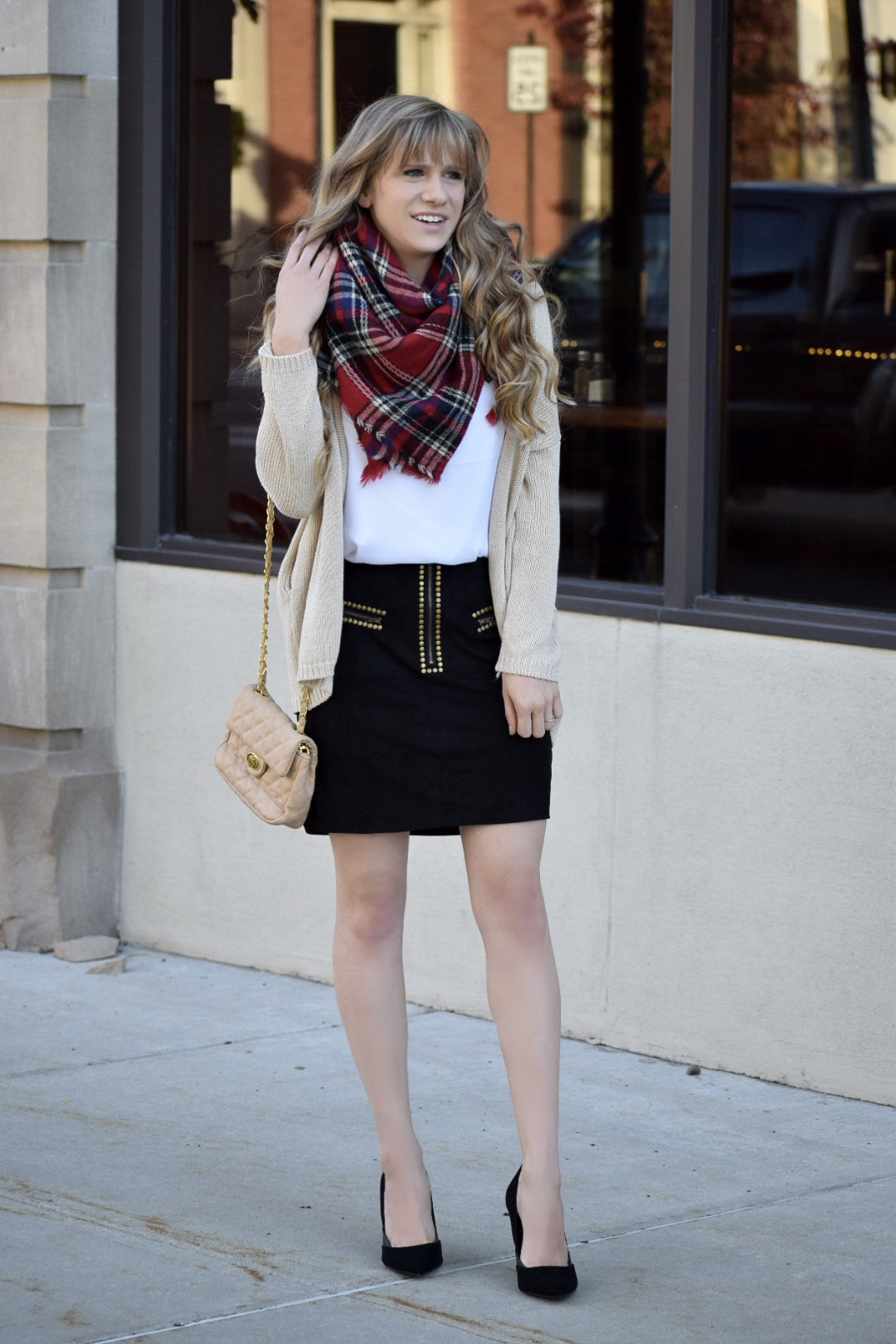 blanket scarf and studded skirt